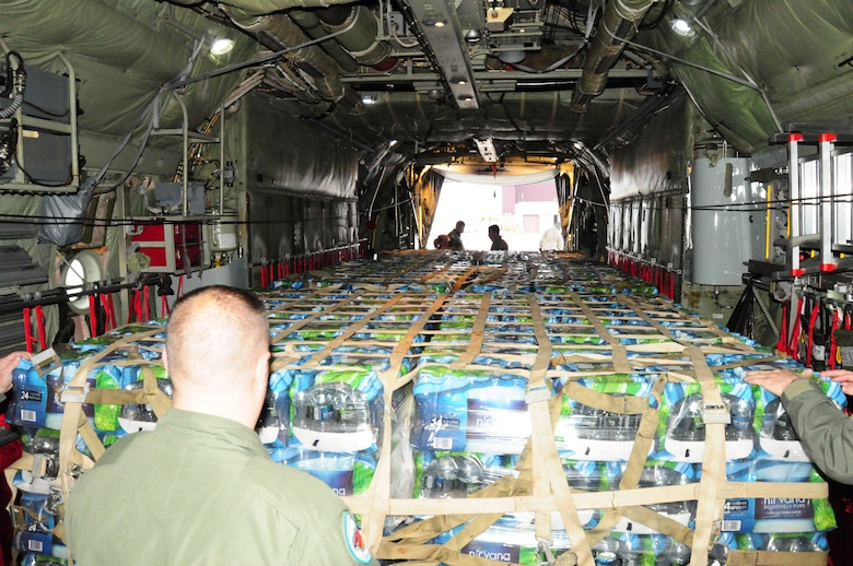 107th Airlift Wing pick up the 30,000 bottles of water at Stewart Air National Guard Base in Newburg, N.Y. before they head to Republic Airport, Farmingdale, NY. Tech Sgt Alan Frankosky, Flight Engineer observed the cargo bay is fully loaded. Nov. 2, 2012 (National Guard Photo/Senior Master Sgt. Ray Lloyd)