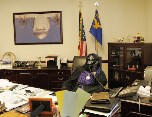 The wing commander, Col. Paul Hargrove (aka Emperor of Evil), is hard at work before the annual Halloween boo-be-que. (photo by: Master Sgt. David Buttner)