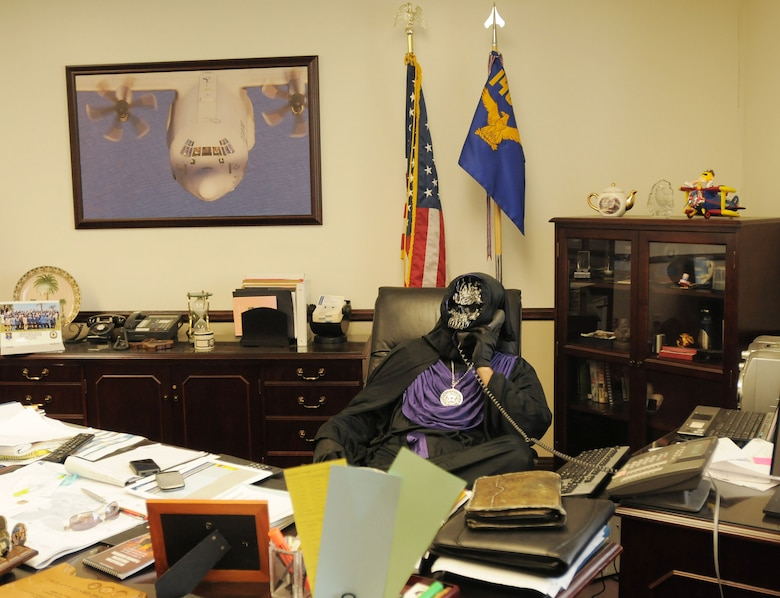 The wing commander, Col. Paul Hargrove (aka Emperor of Evil), is hard at