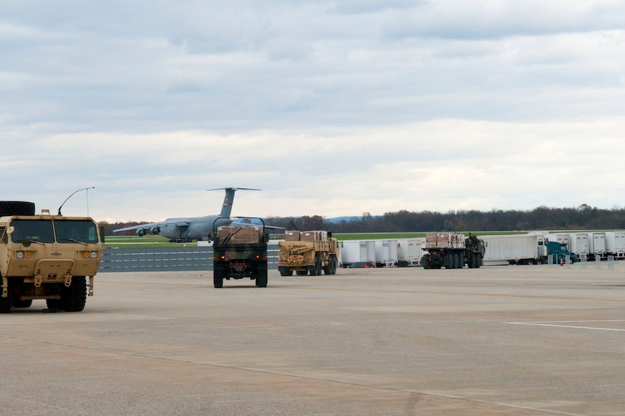 Three trucks, operated by the 77th Brigade's  201st  Forward Support Company,  head off the ramp at the 167th Airlift Wing, Martinsburg, W.Va., Nov.2, 2012. The trucks, full of boxed meals, were destined for Tucker County, W.Va., one of the W.Va. counties with heavy snow and power outages. The 167th AW is serving as a staging area for disaster relief supplies which will then be transported throughout West Virginia as needed. The West Virginia National Guard has over 200 members aiding in recovery efforts from Hurricane Sandy.  The storm blanketed the state with heavy snow and rains and also had severe winds that left homes and properties damaged.  Guardsmen are involved in numerous aspects of the operations from search and rescue missions to debris removal. (Air National Guard photo by Master Sgt. Emily Beightol-Deyerle)