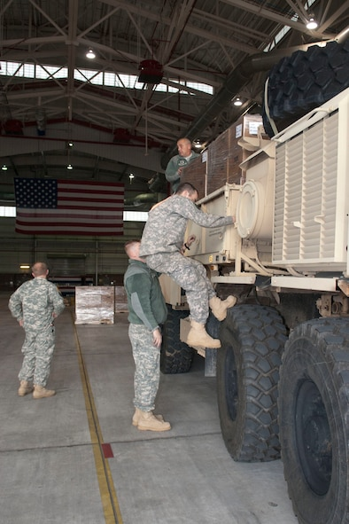 West Virginia National Guardsmen with the 77th Brigade's 201st Forward Support Company and 1201st FSC make final preparations to a truck at the 167th Airlift Wing, Martinsburg, W.Va., Nov.2, 2012.The truck, full of boxed ready-to-eat meals, was destined for Tucker County, W.Va., one of the W.Va. counties with heavy snow and power outages. The 167th AW is serving as a staging area for disaster relief supplies which will then be transported throughout West Virginia as needed. The West Virginia National Guard has over 200 members aiding in recovery efforts from Hurricane Sandy.  The storm blanketed the state with heavy snow and rains and also had severe winds that left homes and properties damaged.  Guardsmen are involved in numerous aspects of the operations from search and rescue missions to debris removal. (Air National Guard photo by Master Sgt. Emily Beightol-Deyerle)