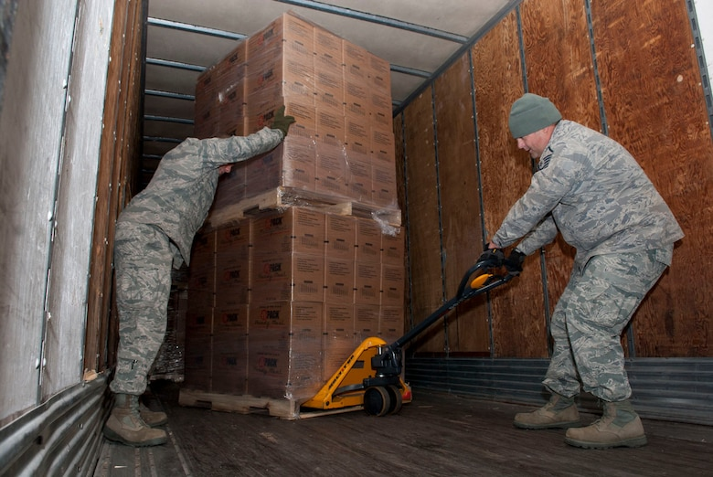 Airmen with the 167th Airlift Wing's small air terminal maneuver pallets of boxed meals on a trailer at the unit based in Martinsburg W.Va., Thursday Nov. 2, 2012. The 167th AW is serving as a staging area for disaster relief supplies which will then be transported throughout West Virginia as needed. The West Virginia National Guard has over 200 members aiding in recovery efforts from Hurricane Sandy.  The storm blanketed the state with heavy snow and rains and also had severe winds that left homes and properties damaged.  Guardsmen are involved in numerous aspects of the operations from search and rescue missions to debris removal. (Air National Guard photo by Master Sgt. Emily Beightol-Deyerle)