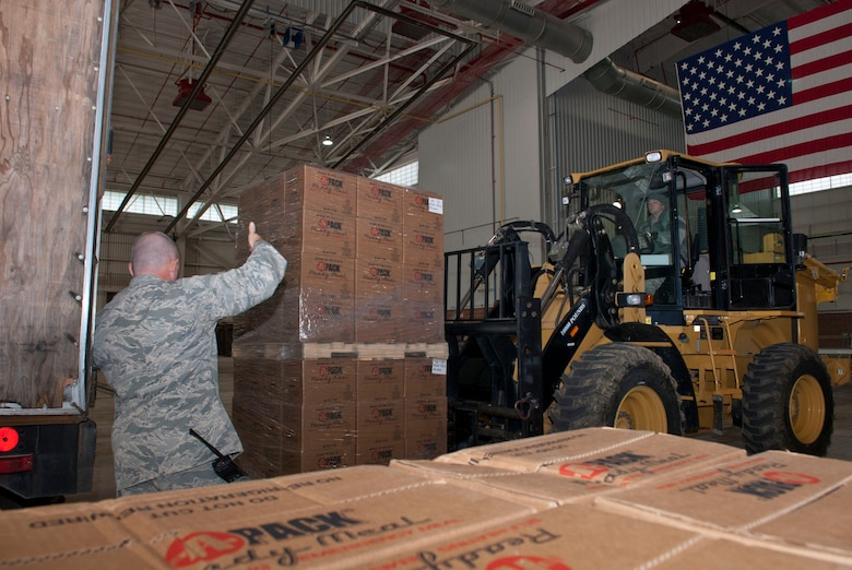 Airmen with the 167th Airlift Wing's small air terminal move pallets of boxed meals off of a trailer at the unit based in Martinsburg W.Va., Thursday Nov. 2, 2012. The 167th AW is serving as a staging area for disaster relief supplies which will then be transported throughout West Virginia as needed. The West Virginia National Guard has over 200 members aiding in recovery efforts from Hurricane Sandy.  The storm blanketed the state with heavy snow and rains and also had severe winds that left homes and properties damaged.  Guardsmen are involved in numerous aspects of the operations from search and rescue missions to debris removal. (Air National Guard photo by Master Sgt. Emily Beightol-Deyerle)