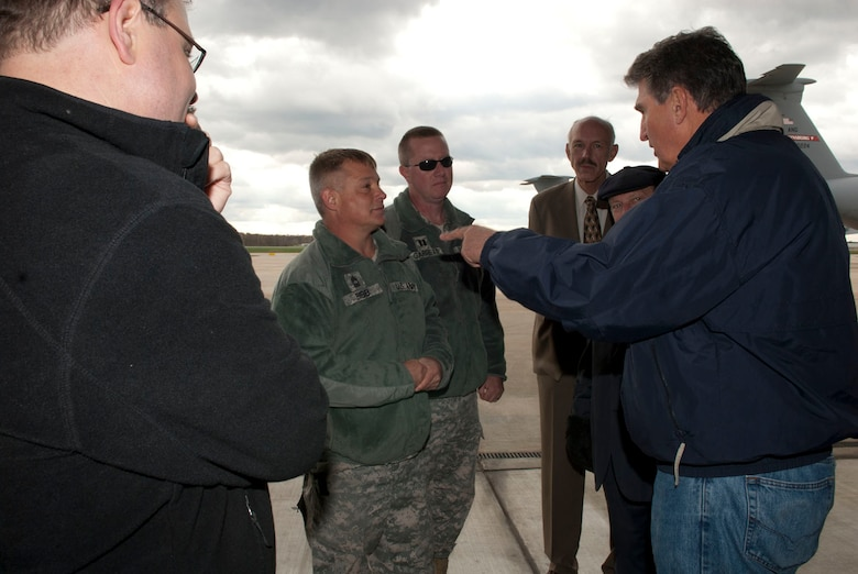 U.S. Senator Joe Manchin, D-W.Va., right, talks with Master Sgt. Keith Bibb and Capt. Douglas Garrett while at the 167th Airlift Wing, West Virginia Air National Guard, based in Martinsburg W.Va., Thursday Nov. 2, 2012. Sen. Manchin, W.Va. Governor Earl Ray Tomblin, and Major Gen. James Hoyer, adjutant general for W.Va., visited the base to survey the disaster relief staging facility in place. The 167th AW is serving as a staging area for disaster relief supplies which will then be transported throughout West Virginia as needed. The West Virginia National Guard has over 200 members aiding in recovery efforts from Hurricane Sandy.  The storm blanketed the state with heavy snow and rains and also had severe winds that left homes and properties damaged.  Guardsmen are involved in numerous aspects of the operations from search and rescue missions to debris removal. (Air National Guard photo by Master Sgt. Emily Beightol-Deyerle)