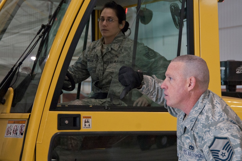 Master Sgt. Jodi Miller signals to Tech. Sgt. Jackquelyn Wandler as she maneuvers pallets off of a FEMA trailer at the 167th Airlift Wing, West Virginia Air National Guard, based in Martinsburg W.Va., Thursday Nov. 1, 2012. The 167th AW is serving as a staging area for disaster relief supplies which will then be transported throughout West Virginia as needed. The West Virginia National Guard has over 200 members aiding in recovery efforts from Hurricane Sandy.  The storm blanketed the state with heavy snow and rains and also had severe winds that left homes and properties damaged.  Guardsmen are involved in numerous aspects of the operations from search and rescue missions to debris removal. (Air National Guard photo by Master Sgt. Emily Beightol-Deyerle)