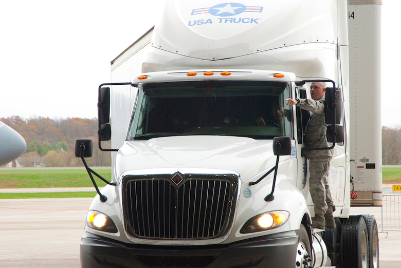 Master Sgt. Jodi Miller directs the driver of a FEMA tractor and trailer to a parking area inside a hangar at the 167th Airlift Wing, West Virginia Air National Guard, based in Martinsburg W.Va., Thursday Nov. 1, 2012. The 167th AW is serving as a staging area for disaster relief supplies which will then be transported throughout West Virginia as needed. The West Virginia National Guard has over 200 members aiding in recovery efforts from Hurricane Sandy.  The storm blanketed the state with heavy snow and rains and also had severe winds that left homes and properties damaged.  Guardsmen are involved in numerous aspects of the operations from search and rescue missions to debris removal. (Air National Guard photo by Master Sgt. Emily Beightol-Deyerle)