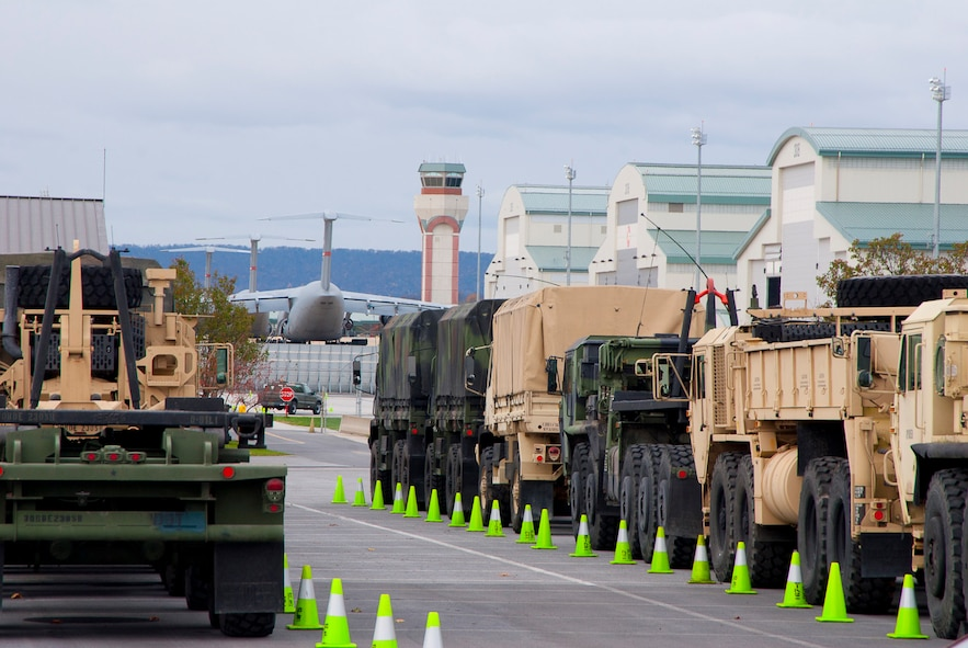 Vehicles assigned to the 77th Brigade's 1201st Forward Support Company based in Kingwood W.Va. and Delta 230th FSC based in Glen Jean, W.Va are parked at the 167th Airlift Wing, West Virginia Air National Guard, based in Martinsburg W.Va., Thursday Nov. 1, 2012. The 167th AW is serving as a staging area for disaster relief supplies which will then be transported throughout West Virginia as needed. The West Virginia National Guard has over 200 members aiding in recovery efforts from Hurricane Sandy.  The storm blanketed the state with heavy snow and rains and also had severe winds that left homes and properties damaged.  Guardsmen are involved in numerous aspects of the operations from search and rescue missions to debris removal. (Air National Guard photo by Master Sgt. Emily Beightol-Deyerle)