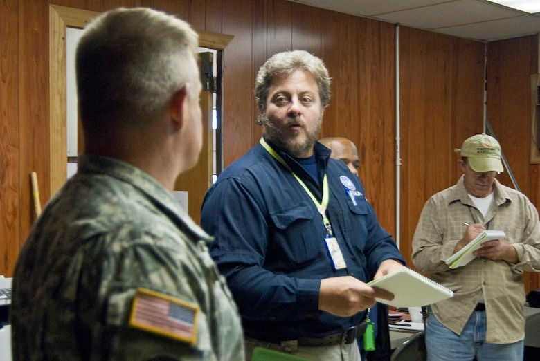 Joseph D'Angelo, Joe D'Angelo, FEMA's Incident Management Assistance Team (IMAT) logistics chief for Region III comments to West Virginia National Guardsman, Master Sgt. Keith Bibb, 77th Brigade property book officer, during a meeting to coordinate operations at the 167th Airlift Wing, West Virginia Air National Guard, based in Martinsburg W.Va., Thursday Nov. 1, 2012. The 167th AW is serving as a staging area for disaster relief supplies which will then be transported throughout West Virginia by the 77th Brigade's 1201st Forward Support Company based in Kingwood W.Va. and Delta 230th FSC based in Glen Jean, W.Va. The West Virginia National Guard has over 200 members aiding in recovery efforts from Hurricane Sandy.  The storm blanketed the state with heavy snow and rains and also had severe winds that left homes and properties damaged.  Guardsmen are involved in numerous aspects of the operations from search and rescue missions to debris removal. (Air National Guard photo by Master Sgt. Emily Beightol-Deyerle)