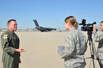 U.S. Air Force Col. Bo Mahaney, 452nd Air Mobility Wing commander is interviewed by Lt. Col. Beth Horine, 4th Combat Camera Squadron commander on the flightline at March Air Reserve Base, Calif., Nov. 4, 2012. The Department of Defense Continues to flow forces, capabilities and logistical supplies to the New York / New Jersey region in support of the Federal Emergency Management Agency's response to Hurricane Sandy. (U.S. Air Force photo by Tech. Sgt. Francisco V. Govea II/Released)