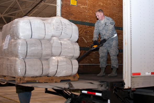 Tech. Sgt. Justin Walther manuevers a pallet of blankets provided by FEMA, Nov. 3, 2012, at the 167th Airlift Wing, Martinsburg, W.Va. FEMA delivered 25,000 blankets to the unit. The blankets were transported to New York via C-130 aircrafts from Little Rock, Ark. (Air National Guard photo by 2nd Lt. Stacy Gault)