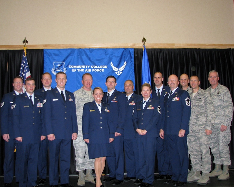 Utah Air National Guard members pose for a Community College of the Air Force graduation photo with UT ANG commanders, Col. Samuel Ramsay, Col. David Osborne, Lt. Col. Matthew Bolduc and Lt. Col. Corey Love at Hill Air Force Base, Utah on October 9. UT ANG members who graduated with the CCAF's October 2012 class include: Senior Master Sgt. Burke Baker, Master Sgt. Robert Bean, 2nd Lt. Amy Bocage, Senior Airman Jeremy Branham, Senior Airman Jennifer Eagle, Staff Sgt. Adam Elsmore, Staff Sgt. Adam Gatherum, Tech. Sgt. Kevin Gowers, Staff Sgt. Travis Grimes, Master Sgt. Guy Hood, Tech. Sgt. Nicholas Hope, Staff Sgt. Mary Huggins, Master Sgt. Lisa Jensen, Staff Sgt. Jennifer Johnson, Senior Airman Tyson Mayfield, Tech. Sgt. Brandon Moses, 2nd Lt. Brian Moss, Senior Master Sgt. Kenny Pena, Staff Sgt. Jaime Phair, Staff Sgt. Brandon Phelps, Master Sgt. Gary Rihn, Senior Master Sgt. Jay Rose, Master Sgt. Perry States and Senior Master Sgt. Merlin Tomshack. (U.S. Air Force photo courtesy of Master Sgt. Julie Nuccitelli)(RELEASED)