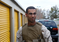 Marine Cpl. Christian Perez, a motor transport operator and a Union City N.J. native takes a break from unloading much-needed donations in the form of diapers, canned foods, clothes and blankets at a relief distribution site in Toms River N.J., Nov. 3, 2012. Following Hurricane Sandy, Marines from 6th Motor Transport Battalion, 4th Marine Logistics Group, utilized their 7-ton trucks to move donated relief supplies to distribution points amongst the most heavily affected areas. (U.S. Marine Corps photo by Staff Sgt. Nate Hauser/Released)