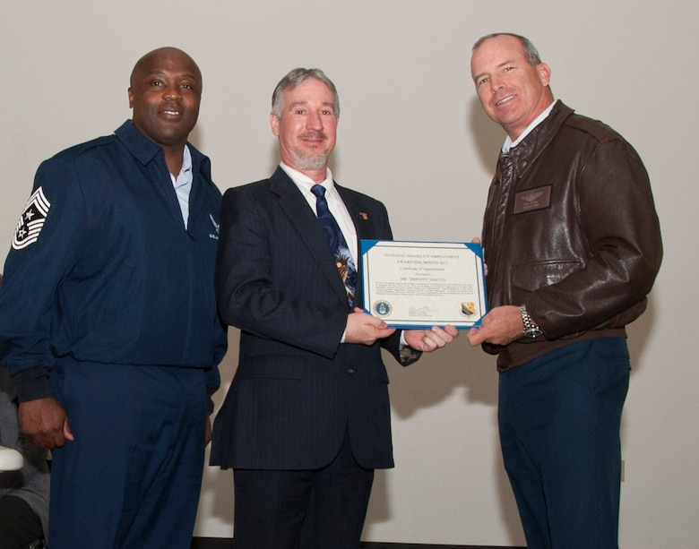 CMSgt Eric Johnson, 82d Training Wing Command Chief and Brig. Gen. Michael Fantini, 82d Training Wing Commander present National Employment Disability Awareness month discussion panel guest speaker Mr. Timothy Shatto with a certificate of appreciation on Oct. 29 at the Solid Rock Cafe.