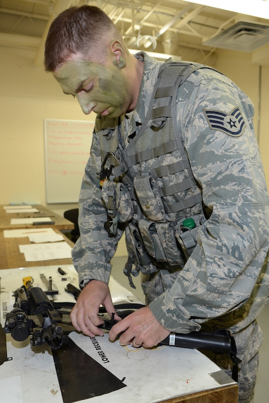 Air National Guard Staff Sgt. Mathew Oleson, fire team leader for the 115th Security Forces Squadron, dismantles an M-4 carbine rifle during weapons qualification training at Truax Field in Madison, Wis. on November 3.  Approximately 30 Airmen from the 115th Fighter Wing Security Forces Squadron participated in the training exercise, which focused on improving combat readiness and weapons familiarization.