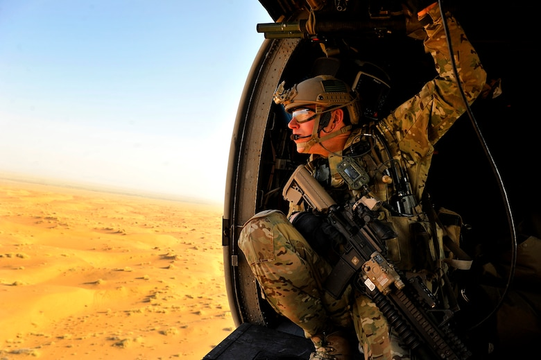 A U.S. Air Force combat rescue officer, 46th Expeditionary Rescue Squadron, conducts a training mission near Kandahar Airfield, Afghanistan, Oct. 29, 2012. Pararescuemen with the 46th ERQS work alongside members of the 26th ERQS, who provide the airlift capability with the HH-60G Pave Hawk variant operated by a crew composed of a flight engineer, pilots, and aerial gunners. (U.S. Air Force photo/Staff Sgt. Clay Lancaster)