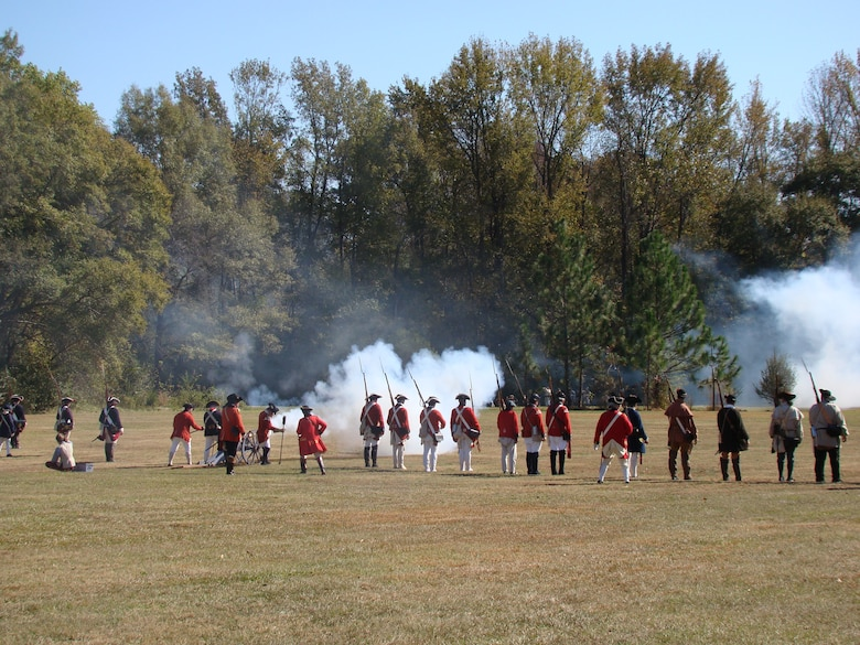 Portraying soldiers of Great Britain, re-enactors face cannons fired by rebel soldiers of the American colonies, about 25 miles north of Shaw Air Force Base at Camden, S.C., Nov. 3, 2012. More than 200 re-enactors, including many military veterans, brought the battlefield back to life 232 years after the event. (U.S. Air Force photo by Rob Sexton/Released)