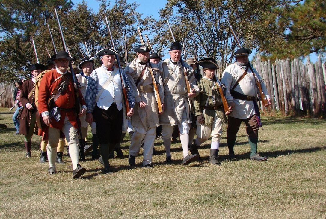 Marching toward the battle, re-enactors portray colonial militiamen of the American War of Independence, about 25 miles north of Shaw Air Force Base, at Camden, S.C., Nov. 3, 2012. Camden was the site of the Continental Army's worst defeat on Aug. 16, 1780. More than 200 re-enactors, including many military veterans, brought the battlefield back to life 232 years after the event. (U.S. Air Force photo by Rob Sexton/Released)