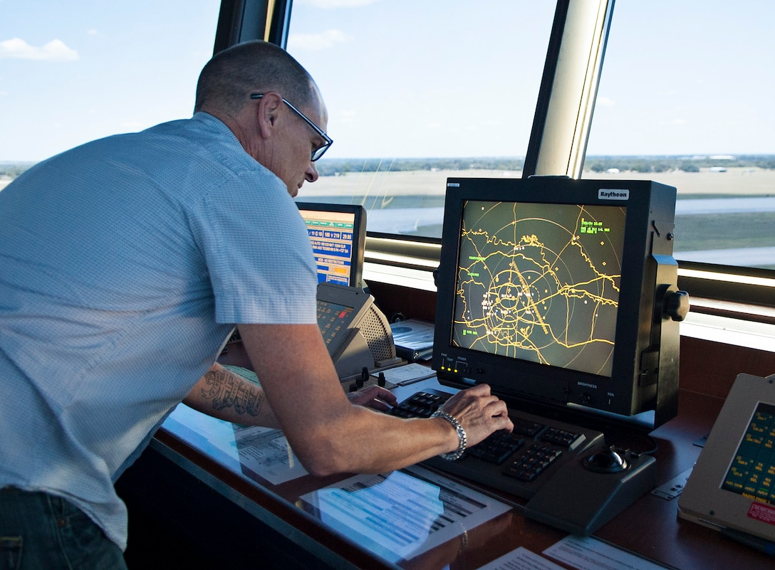 Andrew Lisius, 12th Operations Support Squadron air traffic controller, watches in-and outbound aircraft from his radar screen at the east tower Aug. 14 at Joint Base San Antonio-Randolph. (U.S. Air Force photo by Benjamin Faske)