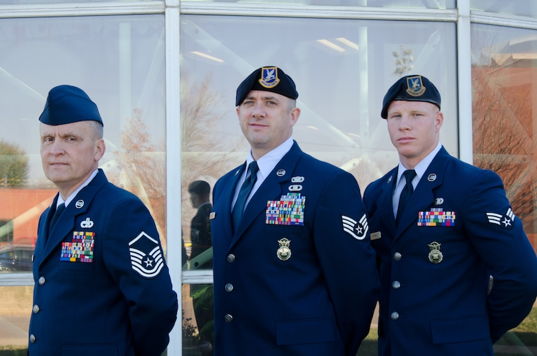 The Missouri Air National Guard, 139th Airlift Wing Outstanding Airmen of the Year, from left, Master Sgt. Thomas Triplett, Staff Sgt. Troy Green and Senior Airman Gregory Haynes, are recognised for their accomplishments Nov. 3 at Rosecrans Air National Guard Base, St Joseph, Mo. (U.S. Air Force photo/Senior Airman Kelsey Ramirez) (Released)