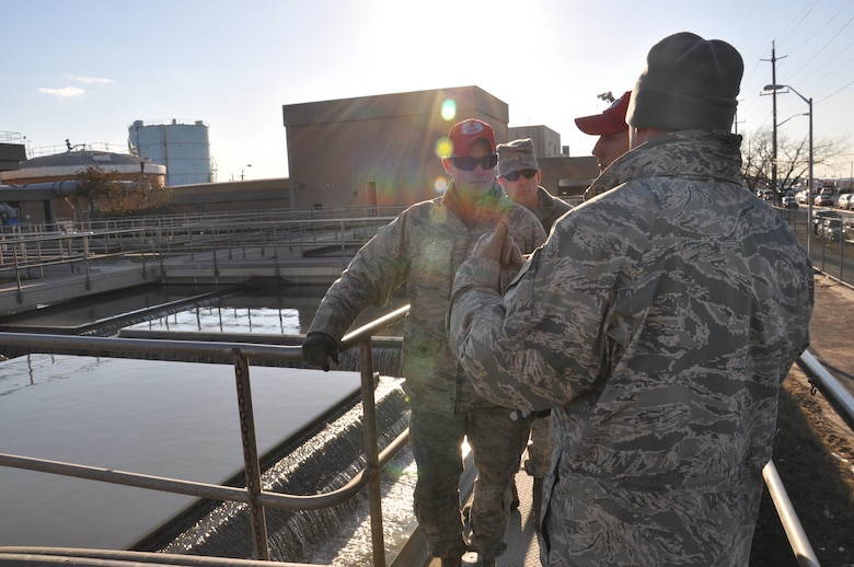 Members of the 331st Air Expeditionary Group discuss plans for assisting the Rockaway wastewater treatment facility in clearing the 500,000 gallon water tanks affected by Hurricane Sandy, Nov. 5, 2012. The 331st AEG is a unit comprised of Air Force civil engineers from 5 different duty locations across the country, whose mission is to support the joint service mission to pump flood waters in critical areas along the New York coastline. (U.S. Air Force photo by Capt. Sybil Taunton/Released)