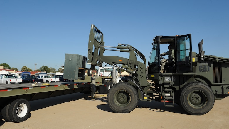 Senior Airman Cody Fleeger, 2nd Logistics Readiness Squadron Vehicle Operations journeyman, operates a forklift to place a training block onto a 45 foot trailer during a training scenario on Barksdale Air Force Base, La., Oct. 31. Vehicle operators support the Barksdale mission by driving aircrew to and from their aircraft as well as delivering parts to maintainers on the flightline. (U.S. Air Force photo/Airman 1st Class Benjamin Gonsier)(RELEASED)