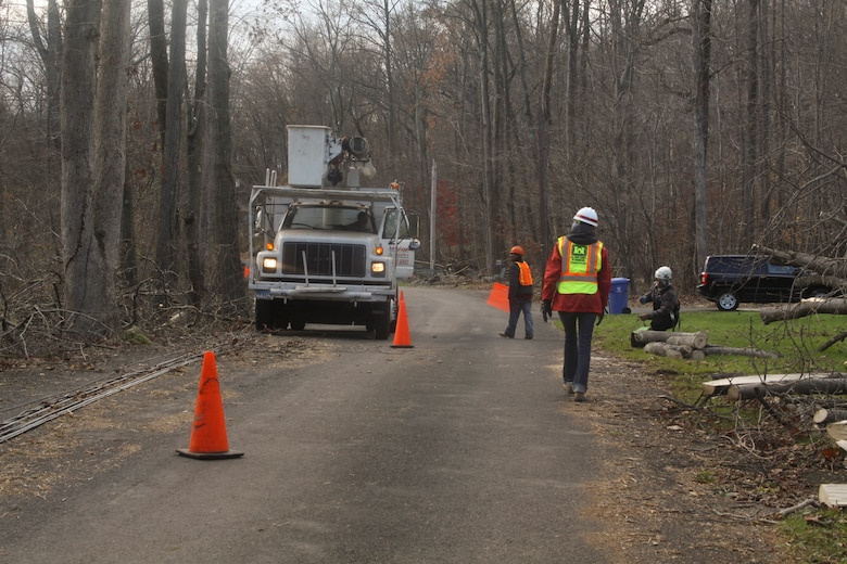LEBANON TOWNSHIP, NJ – Ashley Kosmal, a Baltimore District project engineer, monitors a debris removal crew as they cut away fallen trees from power lines in preparation for power crews to begin to restore power to the area in the wake of Hurricane Sandy. (U.S. Army photo/Patrick Bloodgood)