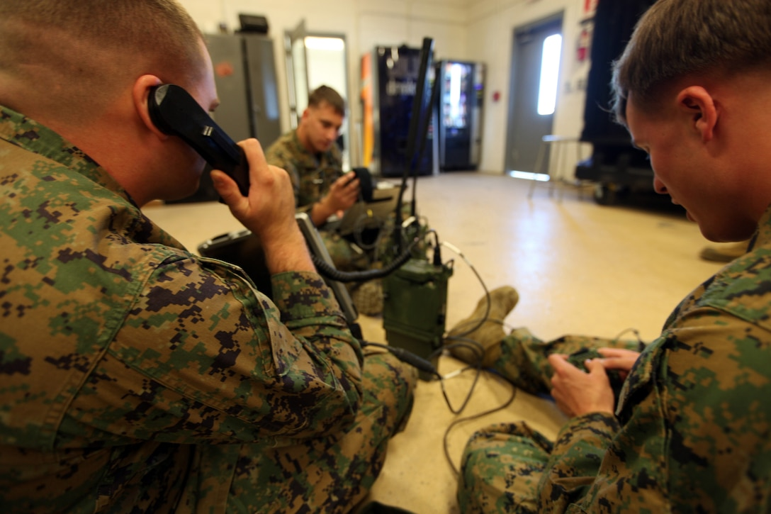 Cpl. James Haynes, from Redding, Calif., Cpl. Travis Miks, from Jackson, Mich., and Cpl. Ryan Neary, from Simi Valley, Calif., all radio operators with the 22nd Marine Expeditionary Unit, familiarize themselves with the AN/PRC-117G Multiband Manpack Radio aboard Marine Corps Base Camp Lejeune, N.C., Nov. 5, 2012. The 22nd MEU recently purchased new equipment and software to familiarize themselves before predeployment training in 2013.