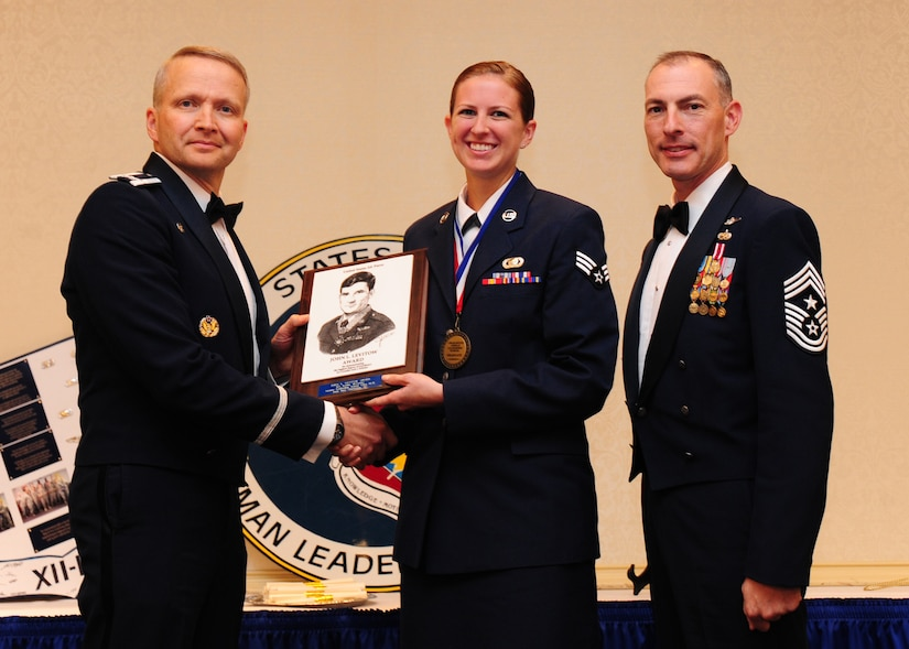 Col. Darren Hartford, 437th Airlift Wing commander and Chief Master Sgt. Larry Williams, 437th AW command chief, present Senior Airman Keitha McCarthy, 437th Operations Group intelligence analyst, the John L. Levitow Award during the Airman Leadership School Class 2012-H graduation ceremony Nov. 1, 2012, at JB Charleston - Air Base, S.C. The Levitow Award is awarded for a student's exemplary demonstration of excellence, both as a leader and scholar. (U.S. Air Force photo/Staff Sgt. Katie Gieratz)