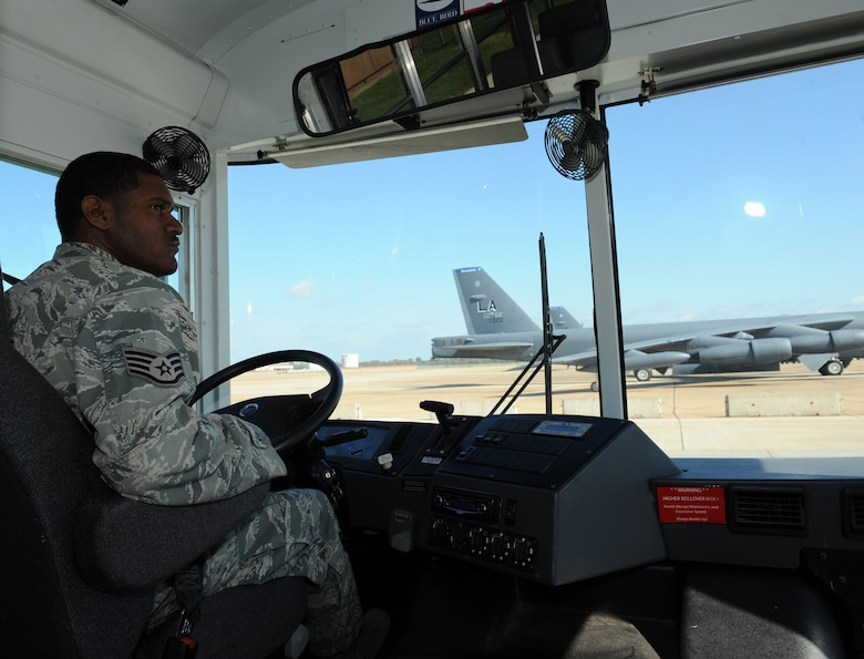 Staff Sgt. Anthony Jones Jr., 2nd Logistics Readiness Squadron Vehicle Operations craftsman, drives a bus on the flightline on Barksdale Air Force Base, La., Nov. 6. Vehicle operators drive high-ranking individuals from the Air Force and its sister services, as well as foreign dignitaries and groups touring the base. (U.S. Air Force photo/Airman 1st Class Benjamin Gonsier)(RELEASED)