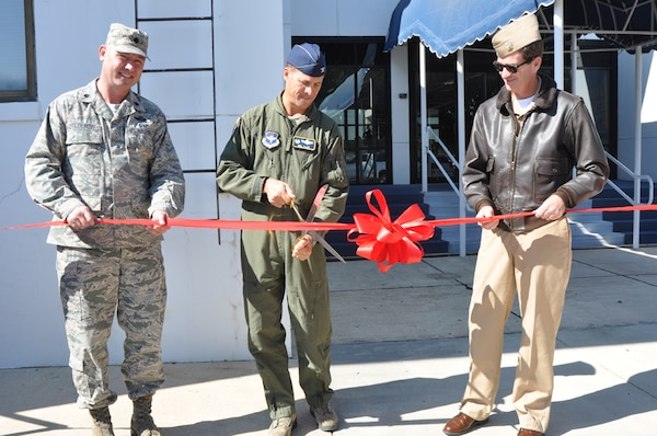 Lt. Col. Justin Boldenow, 479th Operations Support Squadron commander, Col. Neil Allen, 479th Flying Training Group commander, and Navy Capt. Christopher  Plummer, Naval Air Station Pensacola commander, cut the ribbon for the 479th OSS' Pensacola Regional Communications Facility, Oct. 31 at Naval Air Station Pensacola, Fla.  The 3,400 square-foot facility houses a 23-person communications team that provides a full spectrum of services to all Air Force members in the Pensacola region to include Naval Air Stations Pensacola, Corry Station, and Whiting Field.  (U.S. Navy photo by Janet Thomas)