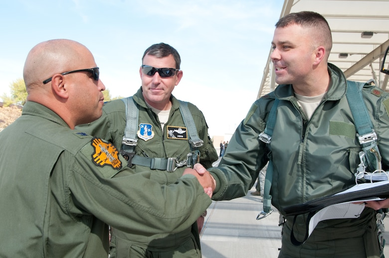 Col. Joe Martinez II (left), 150th Fighter Wing commander, greets Lt. Col. Ronald Hedges (middle) and Maj. Jim Hawkes, A-10 Thunderbolt II pilots Nov. 3 at Kirtland Air Force Base, N.M. More than 150 pilots, maintainers and support personnel from the 124th Fighter Wing, Idaho Air National Guard, traveled to Albuquerque for a weeklong training exercise. (U.S. Air Force photo by Tech. Sgt. Becky Vanshur)
