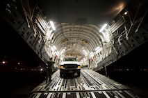 Senior Airman Joshua Bischoff loads a utility truck bound for New York on a C-17 Globemaster III at March Air Reserve Base, Calif., Nov. 1, 2012. Bischoff is a loadmaster with the 15th Airlift Squadron. (U.S. Air Force photo/Staff Sgt. Greg C. Biondo)