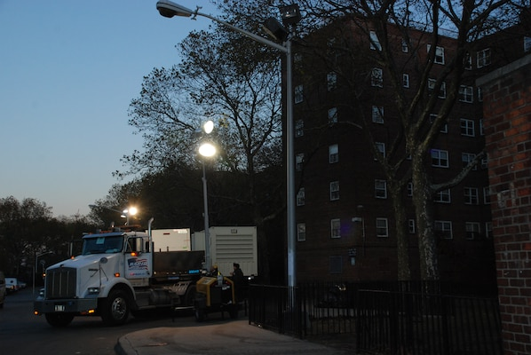 Residents in the Redfern Housing Complex in Far Rockaway, N.Y. had been without power since Hurricane Sandy devastated the northeast a week prior. But because of a joint effort by the U.S. Army Corps of Engineers, other branch components and federal and state partners working through the Federal Emergency Management Agency (FEMA), power is continuing to be restored in Rockaway and other hard-hit areas throughout New York and New Jersey.