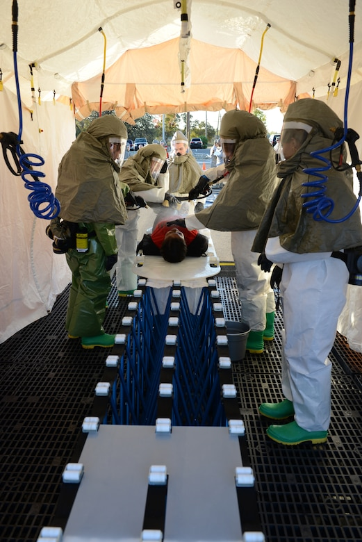9th Medical Group personnel decontaminate a simulated infected Airman during a disease containment emergency management exercise Nov. 7, 2012 at Beale Air Force Base, Calif. The exercise measured the base and specifically the 9th MDG response to a biological emergency. (U.S. Air Force photo by Mr. John Schwab/ Released)