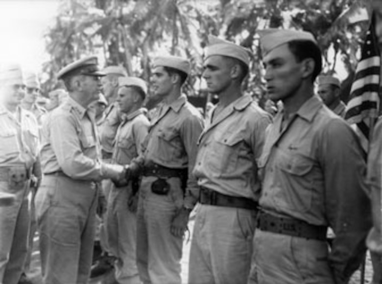 Lt. Gen. Walter Krueger, U.S. Sixth Army commanding general, congratulates Harry D. Weiland, an Alamo Scout, after awarding him the him the Bronze Star for Valor for a mission on Pegun Island in the Philippines. (Courtesy photo)
