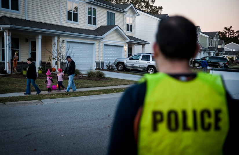 Staff Sgt. Benjamin Stewart, 628th Civil Engineer Squadron Explosive Ordinance Disposal technician, performs pumpkin patrol duty Oct. 31, 2012 at Joint Base Charleston – Air Base housing. Several individuals from the base volunteered to patrol on-base housing at both the Air Base and Weapons Station to ensure children and their families were safe while trick or treating. (U.S. Air Force photo/ Senior Airman Dennis Sloan)