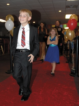 Children dressed in suits and ties, ball gowns and tuxedos were seen strutting their stuff on the red carpet like celebrities as they entered the Town and Country Restaurant's Grand Ballroom, Nov. 3. About 150 people, 72 of them children ages   2 - 14, attended the first-time Kids' Marine Corps Birthday Ball at Marine Corps Logistics Base Albany.