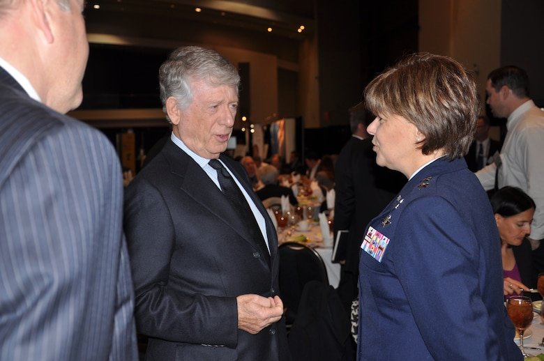 WASHINGTON, D.C. - Ted Koppel, former anchor of ABC News' Nightline, speaks with Maj. Gen. Suzanne Vautrinot, 24th Air Force and Air Forces Cyber commander, at the 2012 Symantec Government Symposium, Nov. 7. Koppel was a keynote speaker at the annual event, where Vautrinot was honored as one of Symantec's 2012 Cyber Award winners. The annual award recognizes leaders who exemplify government cyber security excellence through their contributions to programs that protect national and global data and systems. (U.S. Air Force photo by Christine D. Millette)