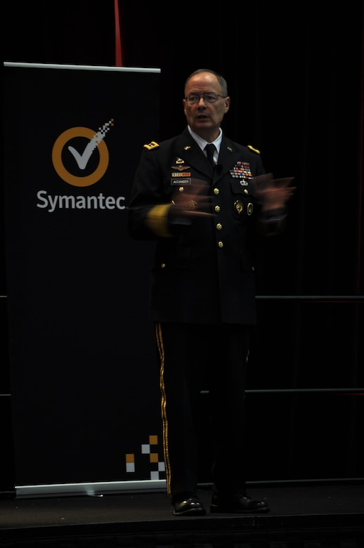 WASHINGTON, D.C. - General Keith Alexander, U.S. Cyber Command commander and NSA director, addresses the crowd at the 2012 Symantec Government Symposium about working as a team in cyber security, Nov. 7. Alexander was a keynote speaker at the annual event, where one of Symantec's 2012 Cyber Award winners was Maj. Gen. Suzanne Vautrinot, 24th Air Force and Air Forces Cyber commander. The annual award recognizes leaders who exemplify government cyber security excellence through their contributions to programs that protect national and global data and systems. (U.S. Air Force photo by Christine D. Millette)