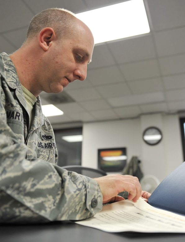 Staff Sgt. Clifford Martin, 509th Force Support Squadron NCO in charge of separations and retirements, prepares a retirement certificate during his shift at the Whiteman Air Force Base Career Development Office Oct. 31. The Career Development Office assists those transitioning in separations or retirements. (U.S. Air Force photo/Heidi Hunt) (Released)