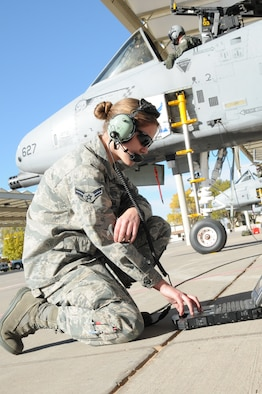 Idaho Air National Guard Airman 1st Class Kendra Kotter, A-10 crew chief assigned to the 124th Maintenance Squadron, reviews a technical order to prepare the launch of an A-10 Thunderbolt II during a training sortie at Kirtland Air Force Base, N.M., Nov. 4.  (U.S. Air Force photo by Tech. Sgt. Becky Vanshur)