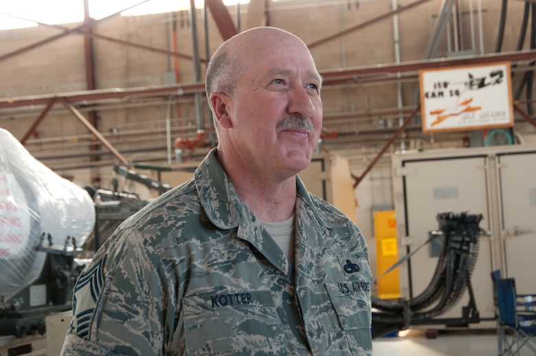 Idaho Air National Guard Chief Master Sgt. Kris Kotter, component maintenance flight chief assigned to the 124th Maintenance Squadron, talks about the weeklong deployment with his two daughters working on the flight line at Kirtland Air Force Base, N.M., Nov. 4. To be able to see them work together on the flight line doing the job they were trained to do is really exciting, Chief Kotter said. (U.S. Air Force photo by Tech. Sgt. Becky Vanshur)