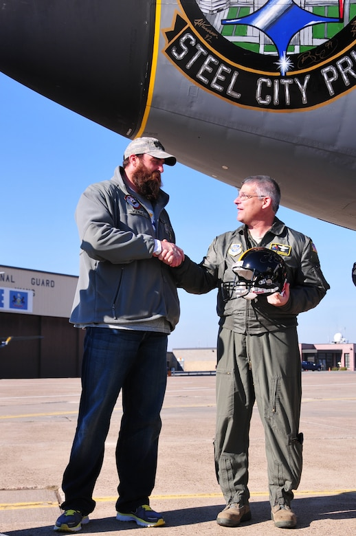 """Four players from the Pittsburgh Steelers: Jonathan Dwyer, James Harrison, Brett Keisel and Doug Legursky visit the 171st Air Refueling Wing, November 6.  The visit, part of the """"Salute to Service"""" campaign, is sponsored by the NFL in conjunction with USAA.  The NFL is also paying tribute to the Armed Forces throughout the month of November.  During the visit, the players take time to autograph one of the unit's KC-135 aircraft, Steel City Pride.  The Salute to Service campaign aligns with the NFL's long history of supporting America's armed services, including a partnership of more than 45 years with the USO that includes overseas visits to troops and trips to military hospitals nationwide.   During the Pittsburgh Steelers' November 12 game, the Steelers will honor a veteran from every war, and recognize a local Harrier pilot who was shot down and killed last month over Afghanistan. The Steelers will also recognize their local military community by paying tribute to the service men and women of the 171st Air Refueling Wing. The team is partnering with USAA for a stadium-wide card stunt that features a special military appreciation message during the National Anthem. Fans will be instructed to hold up the card at their seats just before the National Anthem.   (National Guard photo by Master Sgt. Ann Young/released)"""