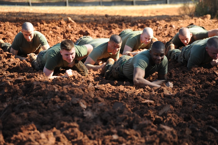 """The general public is invited to Marine Corps Logistics Base Albany's first """"Dirty Devil Dog Mud Run,"""" Saturday, Nov. 17, at Boyett Park on base. Registration begins at 9 a.m. and the race kicks off at 10 a.m. Early entry fee is $25 if registered by Nov. 12; after that the fee is $30. Participants can register on site the day of the event. Registration fee includes a long-sleeved T-shirt (guaranteed for every participant registered by Nov. 12), a participation medallion, hamburgers, hot dogs and drinks after the race. Runners can register online at www.active.com. The Mud Run is not a race, but rather a 3-mile fun run that will introduce members of the community to a Marine Corps-style course run, complete with obstacles, challenges and plenty of mud. All runners must sign a hold harmless waiver prior to participation, and there is no age requirement. Runners younger than 18 must have a parent or guardian sign their waiver, and parents/guardians must accompany all children for the duration of the event. Drivers without base access must have a current vehicle registration and insurance, and a valid driver's license upon entering the gate. Directions to the site will be provided. In addition, the Dirty Devil Dog Mud Run will be an opportunity for members in the community to support the U.S. Marine Corps Reserve's 2012 Toys for Tots campaign. All runners are encouraged to bring an unwrapped toy for the Toys for Tots bin that will be on hand. For more information, call 229-639-7935."""