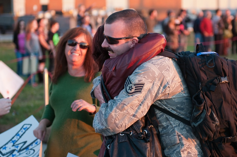 A member of the 123rd Airlift Wing is greeted by loved ones during a homecoming event Nov. 10, 2012, at the Kentucky Air National Guard Base in Louisville, Ky. The Airman was one of 58 Kentucky Guardsmen returning from a four-month deployment to the Persian Gulf. (U.S. Air Force photo by Master Sgt. Phil Speck)