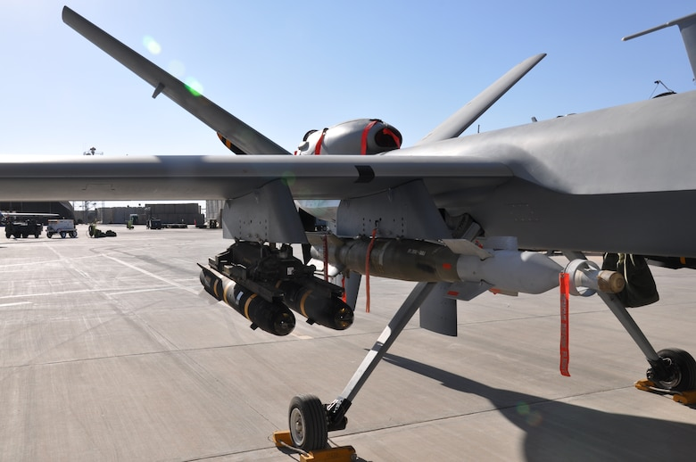 An MQ-9 Reaper at Kandahar Airfield is loaded with AGM-114 Hellfire missiles and a 500-pound GBU-12. The Reaper, maintained by the 451st Expeditionary Aircraft Maintenance Squadron here, is a Remotely Piloted Aircraft. Its primary mission is to hunt and kill the enemy. (U.S. Air Force photo/Capt. Tristan Hinderliter)