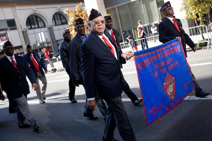 NEW YORK -- Montford Point Marine veterans march in the the annual New York Veterans Day parade, here, Nov. 11.  The Montford Point Marines were the first black Americans allowed to serve in the Marine Corps beginning in 1942. The parade is hosted by the United War Veterans Council, Inc. on behalf of the City of New York. It is the oldest and largest of its kind in the nation. Since November 11, 1919, the parade has provided an opportunity for Americans and International visitors to honor those who have served in the nation's largest city. (Official Marine Corps photo by Cpl. Daniel A. Wulz)