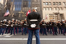 NEW YORK -- A Marine from 6th Communications Battalion, Marine Forces Reserve, paused his formation as they marched in the annual New York Veterans Day parade, here, Nov. 11.  The parade is hosted by the United War Veterans Council, Inc. on behalf of the City of New York. It is the oldest and largest of its kind in the nation. Since November 11, 1919, the parade has provided an opportunity for Americans and International visitors to honor those who have served in the nation's largest city. (Official Marine Corps photo by Bryan Nygaard)