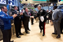NEW YORK, NY - NOVEMBER 12:  United States Marine Corps Major General Michael G. Dana, and Members of the U.S. Armed Forces, ring the opening bell to Commemorate Veterans Day at the New York Stock Exchange on October 12, 2012 in New York City. (Photo by Dario Cantatore/NYSE Euronext)