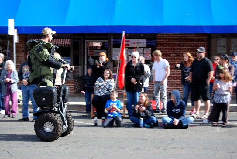 A member of the 9th Civil Engineer Squadron Explosive Ordinance Disposal Flight rides a Segway along the parade route during the Yuba-Sutter Veterans Day Parade in Marysville, Calif., Nov. 11, 2012. More than 400 Team Beale Airmen participated in the parade. (U.S. Air Force photo by Capt. Brian Wagner/Released)